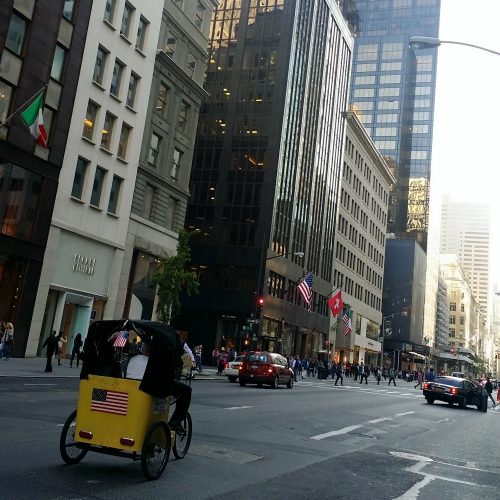 usa-traffic-road-new-york-tricycle-taxi-skyscraper-manhattan-trump-sky
